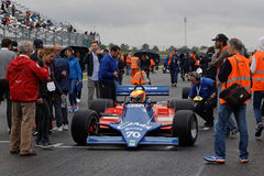 Crowd on the grid. MAGNY-COURS, FRANCE, July 1, 2017 : Crowd on the grid. The First French Historic Grand Prix takes place in Magny-Cours with a lot of ancient Stock Photo