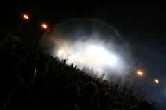 Crowd hands in the air. Crowd of people in a concert stock photos