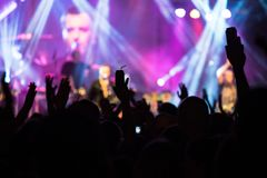 Crowd hands in the air at the concert royalty free stock image