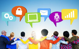 Crowd With Hands On Their Shoulders. And speech bubbles containing symbols Stock Photography