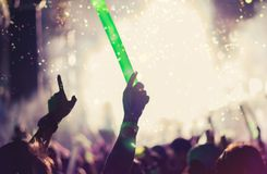 Crowd of hands up concert stage lights stock images