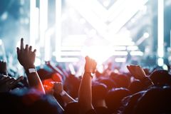Crowd of hands up concert stage and people music party concept royalty free stock image