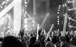 Crowd of hands up glow stick concert royalty free stock image