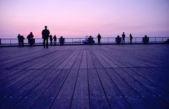 Crowd hanging around in tourist attraction at dusk Stock Photography