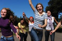 Crowd of happy teen girls running. Crowd of crazy fans running and screaming excited  trying to catch a star Royalty Free Stock Images