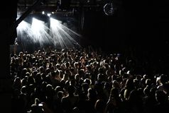 A crowd of heads enjoying music at a nightclub concert venue royalty free stock image