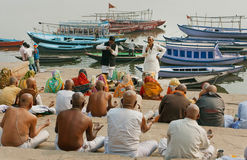 Crowd of hindu people and the teacher gives a lecture about the proper rituals Royalty Free Stock Photo
