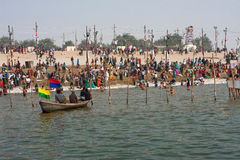 Crowd of hindus come to the river Stock Photos