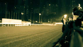Crowd at horse race course edge cheering, taking photo and prepare for game gabling royalty free stock photos