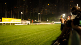 Crowd at horse race course edge cheering, taking photo and prepare for game gabling stock photography