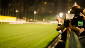 Crowd at horse race course edge cheering, taking photo and prepare for game gabling stock images