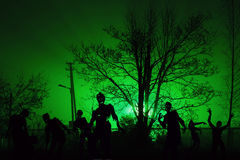 Crowd of hungry zombies near residential buildings Stock Images