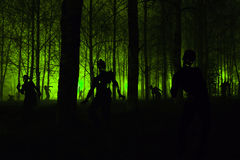 Crowd of hungry zombies in the woods Royalty Free Stock Images