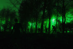 Crowd of hungry zombies in the woods Stock Photo