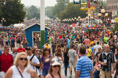 Crowd at Iowa State Fair. DES MOINES, IA /USA - AUGUST 10: Attendees at the Iowa State Fair. Thousands of people filling the midway at the Iowa State Fair on Stock Images