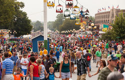 Crowd at Iowa State Fair. DES MOINES, IA /USA - AUGUST 10: Attendees at the Iowa State Fair. Thousands of people filling the midway at the Iowa State Fair on Stock Photos