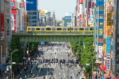 Crowd of Japanese people and the tourist walking and shopping with car traffic at Akihabara district Tokyo Japan. Crowd of Japanese people and the tourist stock images
