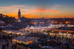 Jemaa el Fna Square, Marrakesh. Crowd in Jemaa el Fna square at sunset, Marrakesh, Morocco. People blur to imply their movements royalty free stock images
