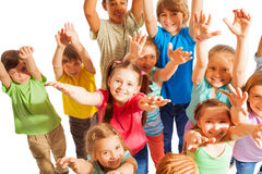 Crowd of kids rise hands up to camera Royalty Free Stock Photography