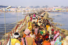 Crowd at Kumbh Mela Festival in Allahabad, India. Crowd crossing pontoon bridge over the Ganges river at Kumbh Mela festival, the world's largest religious Royalty Free Stock Photos