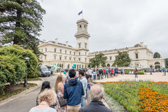 Crowd lines up Open Day. Crowd lining up for an open day entry to Government House, Melbourne, Victoria, Australia Royalty Free Stock Image