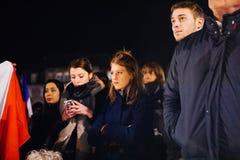 Crowd listening to speach in center of Strasbourg. STRASBOURG, FRANCE - NOV 18, 2015: Sad people listening to speach in center of Strasbourg, in solidarity for Stock Images