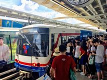 A crowd of locals and tourists line up to board the BTS sky train. stock photos