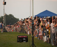 Crowd looking on as the balloons take off. The crowd eagerly awaits an evening lift off at the 2015 New Jersey Festival of Ballooning. The festival is held at Royalty Free Stock Image