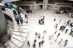 Crowd at louvre entree. Young tourists look at the Musée du Louvre, Paris, France.i Royalty Free Stock Photos