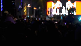 Crowd Making Party at a Rock Concert. Hands Hold Cameras with Digital Displays stock video footage