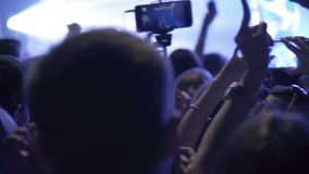 Crowd making party at rock concert and hands hold many cameras with digital displays among people. Hands hold many cameras with digital displays among people stock video