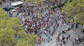 Demonstrators for independence in barcelona wide view. The crowd march and carry estelada flags, pro separatist catalan flag, during a demonstration to hear the Royalty Free Stock Photo