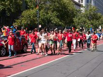 Crowd of marchers at 2017 SF Gay Pride Parade. SAN FRANCISCO, CA – JUNE 25, 2017: Crowd of marchers at 2017 SF Gay Pride Parade. Group comprised of Oracle Royalty Free Stock Images