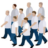 Crowd of men moving in jeans and T-shirt to the common direction Royalty Free Stock Photography