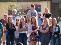 Crowd of men and women in city. Adelaide, Australia - February 20, 2017: A crowd of people being entertained by a street performer in Rundle Mall Royalty Free Stock Photos
