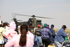 Crowd and the military helicopter Royalty Free Stock Photo