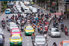 Crowd of motorbikes drive at Ratchaprasong Junction Royalty Free Stock Images