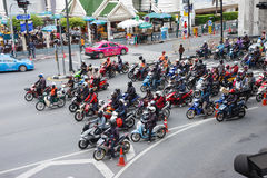 Crowd of motorbikes stand in red traffic light Royalty Free Stock Photography