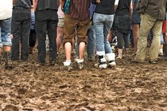 Crowd in mud at concert Stock Image