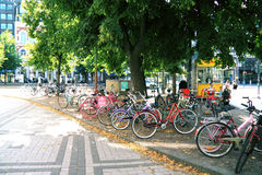Crowd of multi-colored bicycles on parking in street in Helsinki stock photography