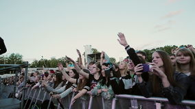 Crowd at a music concert, audience raising hands stock footage