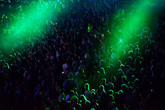 Crowd at a music concert, audience raising hands up Stock Images