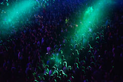 Crowd at a music concert, audience raising hands up Stock Photos