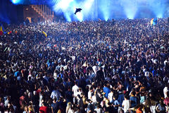Crowd at a music concert, audience raising hands up Royalty Free Stock Images