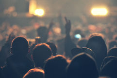Crowd at a music concert, audience raising hands up Royalty Free Stock Photography