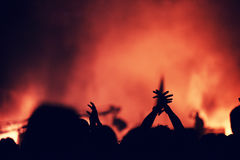 Crowd at a music concert, audience raising hands up Royalty Free Stock Photos