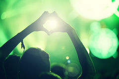 Crowd at a music concert, audience raising hands up Royalty Free Stock Photo
