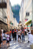 Crowd on a narrow city street Stock Photos