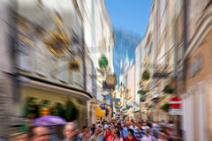 Crowd on a narrow city street Stock Images