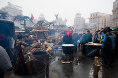 Crowd near street kitchen on during anti-government protest in Kiev. KYIV, UKRAINE: Many demonstrators warm themselves near street kitchen on the crowded street Royalty Free Stock Images
